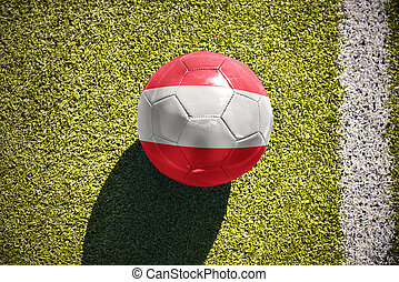 football ball with the national flag of austria lies on the field