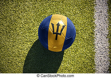 football ball with the national flag of barbados lies on the field