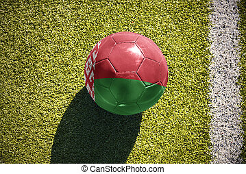 football ball with the national flag of belarus lies on the field