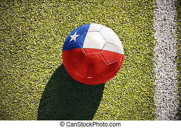football ball with the national flag of chile lies on the field