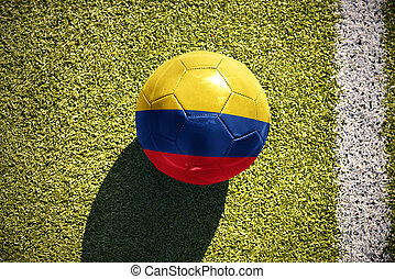 football ball with the national flag of colombia lies on the field