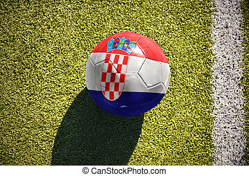 football ball with the national flag of croatia lies on the field