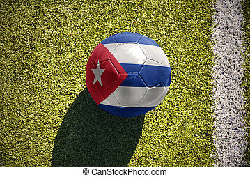football ball with the national flag of cuba lies on the field