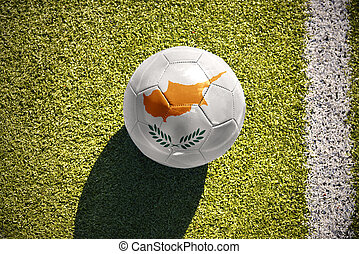 football ball with the national flag of cyprus lies on the field