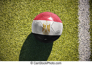 football ball with the national flag of egypt lies on the field
