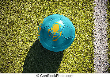 football ball with the national flag of kazakhstan lies on the field