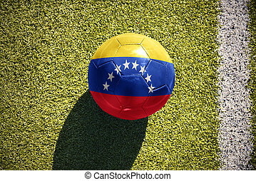 football ball with the national flag of venezuela lies on the field