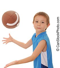 Young boy playing with an American style football isolated