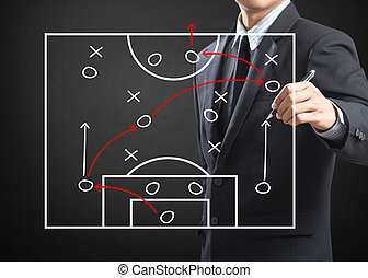 Football coach writing strategy of attacking game