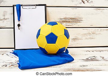 Football equipment and trainer's clipboard