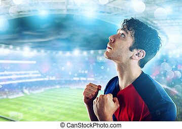 Football fan at the stadium with victory gesture