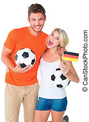 Football fan couple cheering