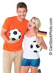 Football fan couple cheering
