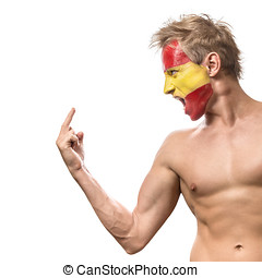 Football fan with spain flag painted over face