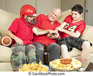 Football Fans Fight for Remote - American football fans-...