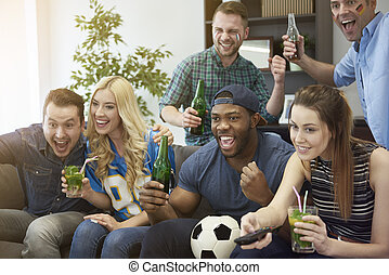 Football fans in the living room
