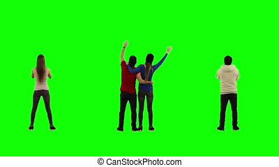 Real people, shot on green screen. 8 people cheering their favourite team. Men and women.