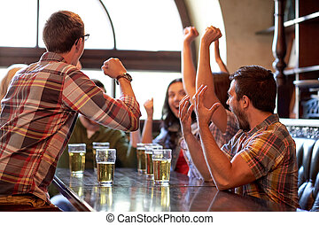 football fans or friends with beer at sport bar