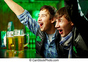 Football fans - Happy men shouting while watching football...