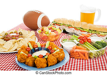 Football Feast - Table spread with appetizer trays for the...