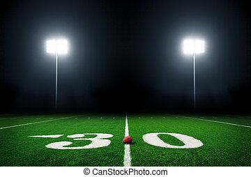 Football field - American football field at night with ...