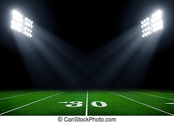 Football field - American football field at night with...