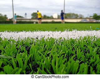 Football field, astro turf surface. Close up of throw in, ...
