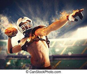 Football fireball - Football player throws a fireball with...