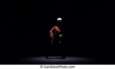 Football freestyle at dark studio. Slow motion - Slow motion...
