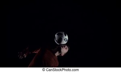 Football freestyle. Close-up football player making tricks...