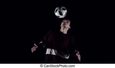 Football freestyle. Football player making tricks with ball...