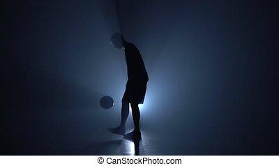 Football freestyle. Silhouette of slim figure. -...