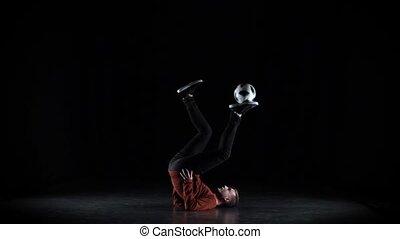 Football freestyle. Slow motion football freestyler...