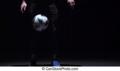 Football freestyle. Slow motion of a brunet fellow making...