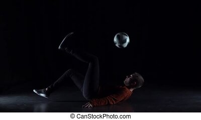Football freestyle. Slow motion of player making tricks with...