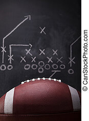 Football Game Plan - An American football and a hand drawn...