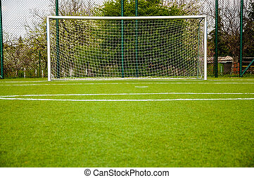 football gate on green sport court