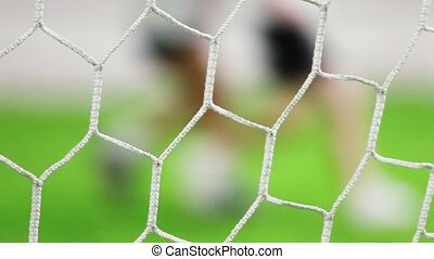 Football gates grid in focus. Children playing football on a background