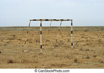 Football goal in the desert.