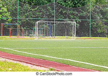 Football goal on a green field on a background