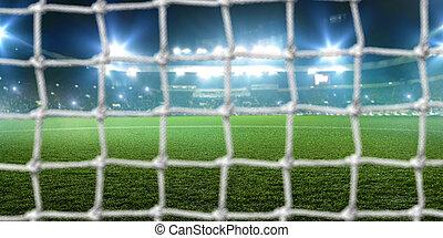 Football goal on stadium, shiny lights and tribune