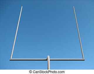 American football field goal posts against the clear sky.