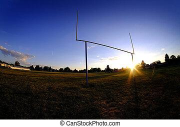 Football Goalposts Goal Posts at Sunset Sky and Bleachers