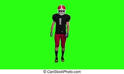 Football goes in sports gear and boots. Slow motion, green screen