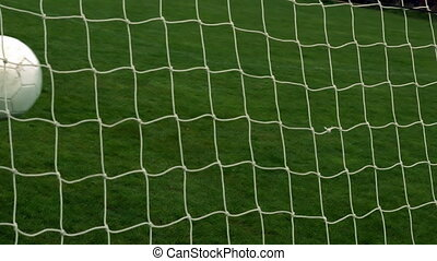 Football hitting the back of the net in slow motion