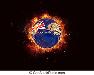 Football in flames with flag of cayman islands