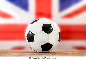 football in front of the british flag