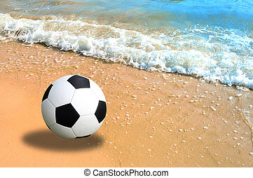 Football in the sand at the beach