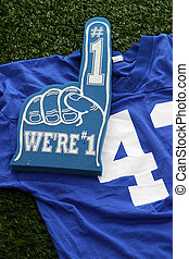 Football Jersey - Football jersey laying against a football...
