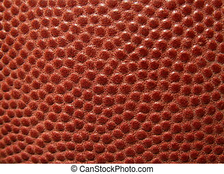 macro of the leather on an American football